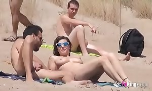 This babe fucks a guy in a beach luxuriant voyeurs
