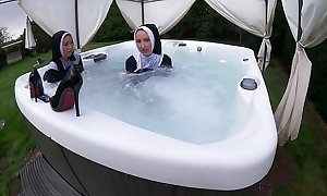 Two naughty nuns acquire sopping in the sexy tub